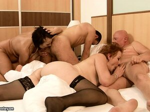 Mature couple and the young one do nice fucking in one and the same broad bed