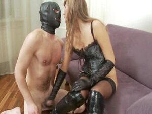 hooded slave gets to cum over the boots of his mistress