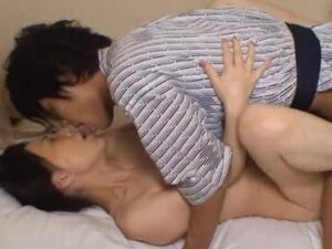 Big Breasted Japanese MILF Takes It Deep In Her Bedroom.