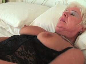 Chubby grandma in stockings rubs her pierced clit