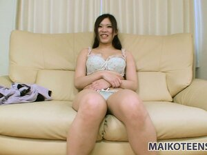Sexy Asian girl Eri strips off her underwear to reveal her big boobs and her tight cunt