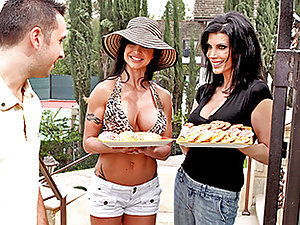 Jewels is a sexy Milf minding her own business gardening away. She looks up and what does she see? A nice young buck moving into the neighborhood. She goes over with her friend Shay to welcome him with a nice plate of cookies. They get to talking and find