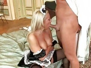Horny maid Britney Spring cleans up meaty cock with sexy mouth