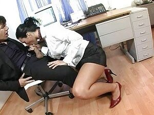 Horny dark haired secretary sucks stiff bazooka in office