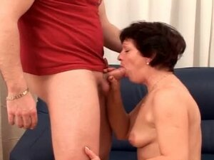 Short haired mature minx sucking off younger man