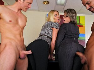 A pair of office sluts get busy with two of the executives riding them side by side