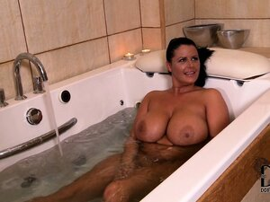 In the bathtub, two stacked brunettes enjoy a fun time pleasing each other's twats