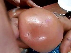 Tattooed brunette with sexy oiled ass gets banged anal