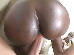 Lusty ebony bitch with huge ass pumped hard on the sofa