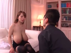Hot MILF Hitomi exposes her huge boobs for a fuck