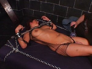 Naughty babe chained and tortured