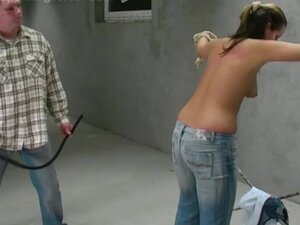 Girl in jeans whipped on the back