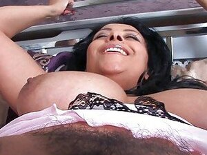 Dark haired honey with huge melons rubbs her hairy twat