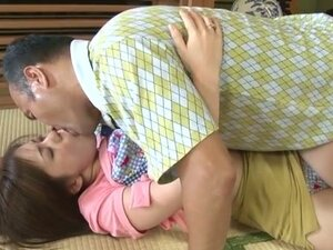 Busty Japanese mom lets her hubby play with her awesome tits