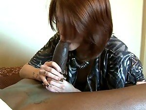 Big Breasted Brunette MILF Heals a Black Cock With A Blowjob