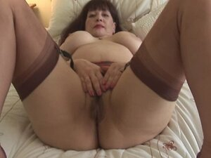 Busty hairy mature lady in sheer panties strips and toys