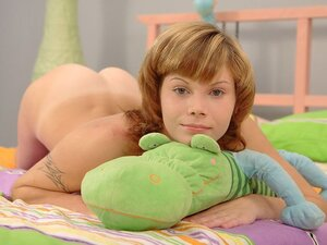 A pale and pretty teen gets her holes filled with a large meat stick in her bed