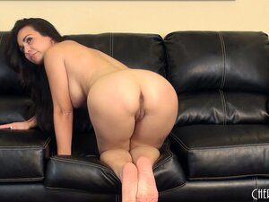 Holly shows of her wonderful body on the couch, yearning for some action