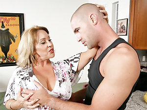 Miss Cox comes to see Charles unexpectedly because she is scared about the poor health of her son. She wants him to train him because Charles is in such good shape. She is very emotional, and when she feels Charles young, hard body, she just can't help he