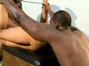 A young stud lies on his back and surrenders his tight holes to two big black cocks