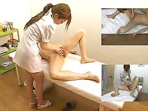 An Asian nurse gives a hottie a special kind of minge massage with oil