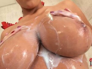 Bombastic blonde with super-sized tits takes a nice hot shower