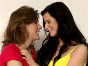 Sexy brunette and redhead lesbians kissing and having lesbian sex on the couch