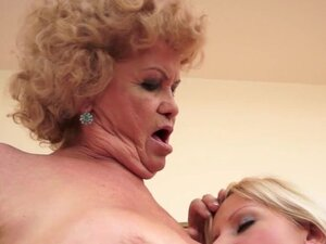 Curly-haired mature kisses sexy young blonde