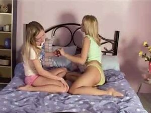 Young two lesbian schoolgirls get naked and lick their small tits