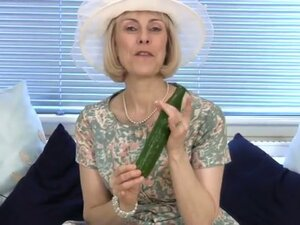 Horny granny takes a cucumber down her wet, moist pussy