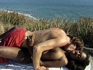 The black sexy ebony drilled by a white dick in the sea beach