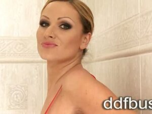Blonde Sharon Pink enjoys a hot shower in her bathroom with a bottle of pink milk!She works those gargantuan titty's of hers like there is no tomorrow, flicking and peppering her juicy nipples giving us amazing closeup views!
