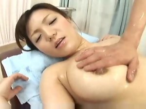 He removes her bikini to massage her naked body
