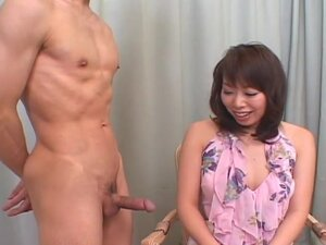 Amateur MILF in a short skirt jerks and sucks a cock