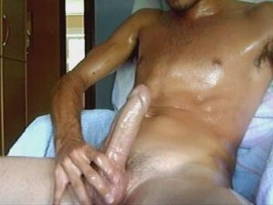 Young shining body guy stroking big dick