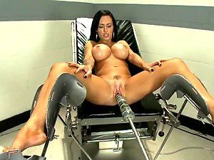 Hugely Breasted Brunette Slut Fucked by Two Machines