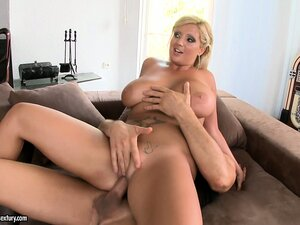 The busty blonde enjoys the double penetration and welcomes their cum on her tits