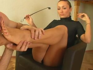 Black turtleneck on gorgeous girl getting feet licked