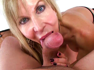 Mature blonde pleases with oral