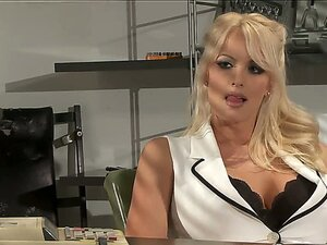 Heavy chested golden haired hottie Stormy Daniels in provocative blouse gets into her office and seduces a nice dude, making him really turned on from the other side of the table