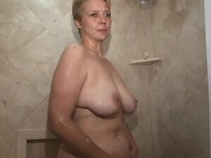 Curvy mom showers and sucks cock