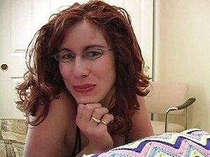 Cock loving redhead milf with glasses gets facial on bed