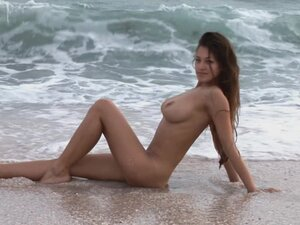 Get busy with big tits on beach