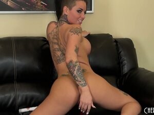 Christy Mack uses a bendy red rubber dildo to fuck her mouth