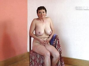 Granny with big tits fucks dildo
