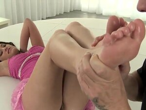 Beautiful Lexi Little is pleasing her boyfriends dick by rubbing it with her awesome slim feet. Enjoy the hot feet action of this awesome tee babe on camera.