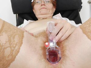 Granny nurse shows her wide snatch