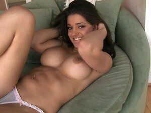 Nude Uma Stone is fingering her shaved cunt