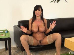 Lisa Ann spreads her legs while wearing a pair of nylon stockings