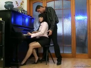A long haired girl is practising her piano lessons when her boyfriend comes up to her and starts to fondle her tits. He undresses her more and starts fucking her pussy and asshole in turns before coming over her behind.